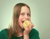 Portrait of a cheerful teen girl with an apple Stock Photography