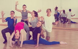 Portrait of cheerful teenagers posing at dance class. Portrait of cheerful teenagers posing together at dance class royalty free stock photography