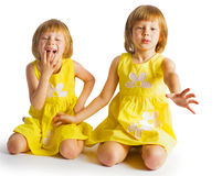 Portrait of cheerful twin sisters hugging and smiling at cam Royalty Free Stock Images