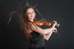 Portrait of a cheerful violinist Stock Photos