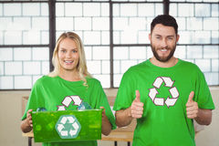 Portrait of cheerful volunteers in recycling symbol tshirts Stock Photo