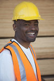 Portrait of a cheerful warehouse worker Stock Photos