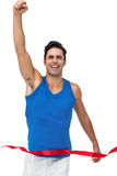 Portrait of cheerful winner athlete crossing finish line Royalty Free Stock Photography