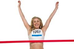Portrait of cheerful winner athlete crossing finish line Stock Photos