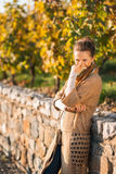 Portrait of cheerful  woman in autumn park hiding behind scarf Royalty Free Stock Photos