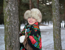 Portrait of the cheerful woman of average years in the winter pine wood Royalty Free Stock Images