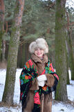Portrait of the cheerful woman of average years in the winter pine wood Stock Images