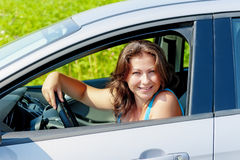 Portrait of a cheerful woman in car Royalty Free Stock Photos