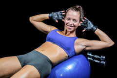 Portrait of cheerful woman on exercise ball Stock Photo