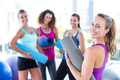 Portrait of a cheerful woman in fitness studio Stock Images