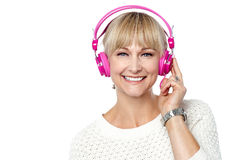 Portrait of a cheerful woman with headphones on Stock Images