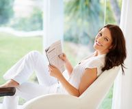 Portrait of a cheerful woman holding newspaper Royalty Free Stock Photo