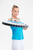 Portrait of a cheerful woman holding tennis racket Royalty Free Stock Images