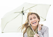 Portrait Of Cheerful Woman Holding Umbrella Stock Photo