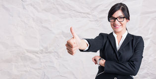 Portrait of cheerful woman manager giving a thumbup Stock Photo