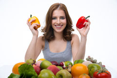 Portrait of a cheerful woman with many fruits Royalty Free Stock Photography