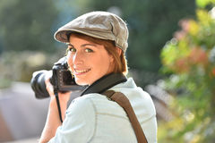 Portrait of cheerful woman photographer at work Royalty Free Stock Photo