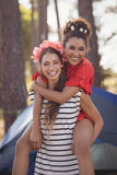 Portrait of cheerful woman piggybacking her female friend Stock Image