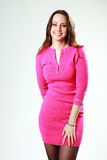 Portrait of a cheerful woman in pink dress Royalty Free Stock Photography