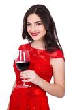 Portrait of cheerful woman in red dress with glass of wine isola Royalty Free Stock Photography