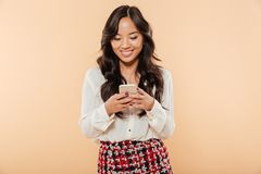 Portrait of cheerful woman scrolling feed or reading text messag Royalty Free Stock Photos