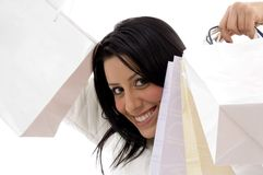 Portrait of cheerful woman showing shopping bags Royalty Free Stock Photography