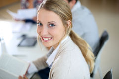 Portrait of cheerful woman studying in class Stock Photos