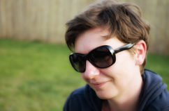 Portrait of cheerful woman with stylish sunglasses. stock photography