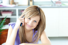 Portrait of a cheerful woman using a phone Stock Images