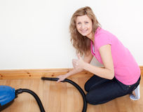 Portrait of a cheerful woman vacuuming Stock Images