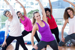 Portrait of cheerful women exercising with arms raised Royalty Free Stock Image