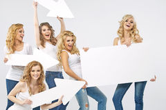 Portrait of cheerful women holding arrows Royalty Free Stock Image
