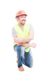 Portrait of cheerful worker kneeling and doing thumbup Royalty Free Stock Photos