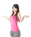 Portrait of cheerful young asian woman shrugging Royalty Free Stock Photos