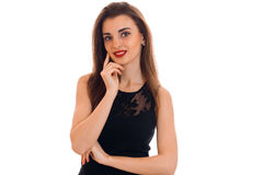 Portrait of cheerful young brunette with red lips in black dress looking at the camera and smiling isolated on white Royalty Free Stock Photography