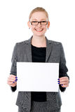 Portrait of cheerful young business woman holding a white blank Stock Photo