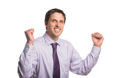 Portrait of a cheerful young businessman cheering Stock Image