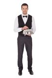 Portrait of a cheerful young butler Royalty Free Stock Images