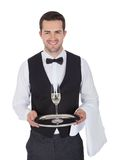 Portrait of a cheerful young butler Royalty Free Stock Image