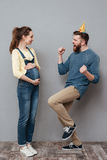 Portrait of a cheerful young couple celebrating pregnancy Royalty Free Stock Photos