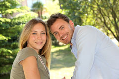 Portrait of cheerful young couple outdoors Stock Photo