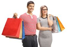 Portrait of a cheerful young couple posing with shopping bags. Isolated on white background stock images