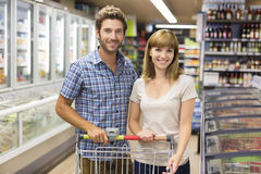 Portrait of cheerful young couple in supermarket. Looking camera Stock Photography