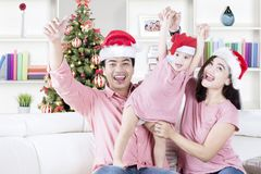 Young family celebrating Christmas together Stock Photo