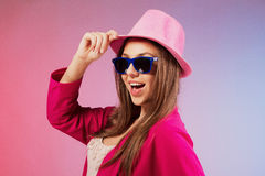 Portrait  of a cheerful young girl in bright casual clothes smil Stock Photography