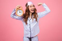 Portrait of a cheerful young girl dressed in pajamas Stock Image