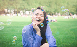 Portrait of a cheerful young girl in soap bubbles Stock Images