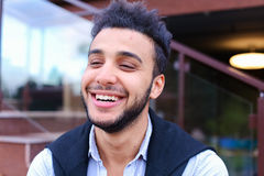 Portrait of cheerful young male Muslim. Man smiling and posing a Stock Image