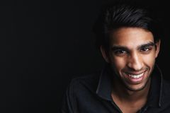 Portrait of a cheerful young man laughing Royalty Free Stock Images