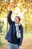 Portrait of a cheerful young man laughing outdoors Stock Photography